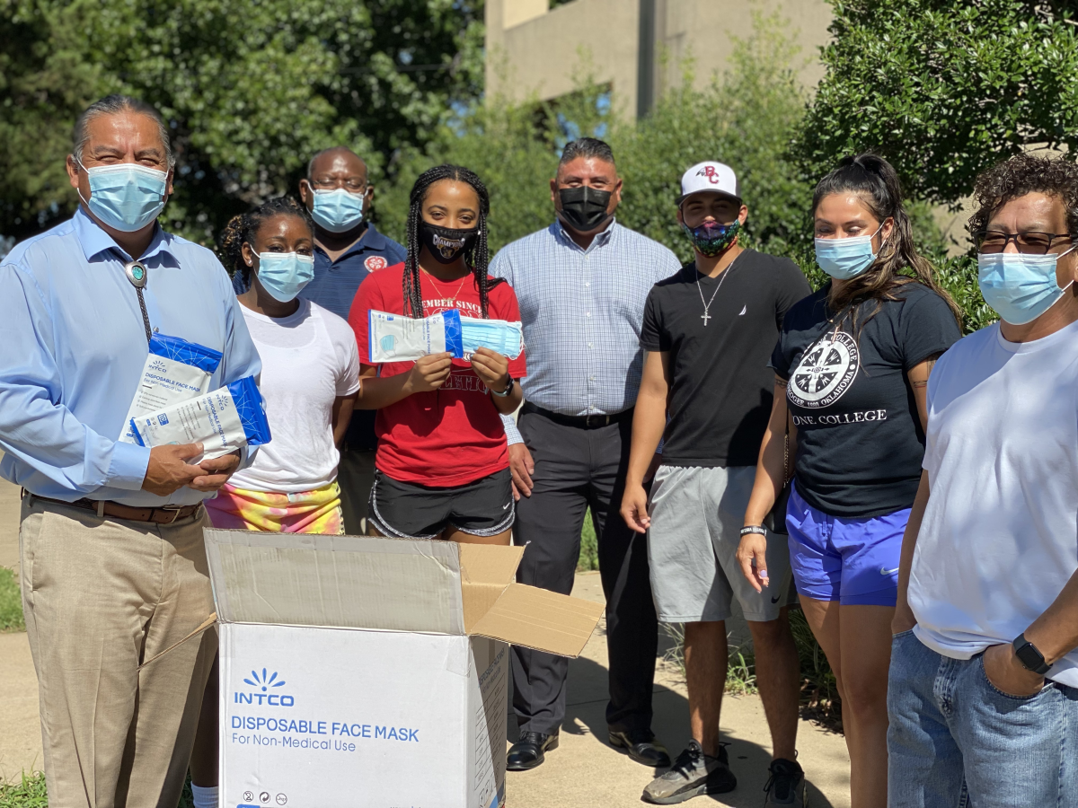 Pictured: President Dr. Ferlin Clark, left, student Jerimontie Hester, Accountant Oliver Thompson, student Za'Riah Griffin, Human Resources Director William Lowe, student Dawson Orso, Head Women's Basketball Coach Tera Cuny-Baker, and Raul, a delivery driver for 115 Management Inc. pause for a photo with 2,000 face masks donated by Ice Cube and Derrick Armstrong with 115 Management Inc.