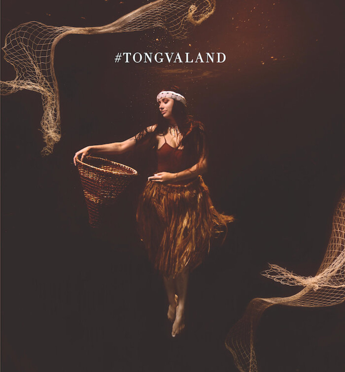 """This work by Indigenous artist Cara Romero, """"Weshoyot,"""" is part of an installation of art billboards in Los Angeles drawing attention to the Tongva people. The billboard features an underwater photo of artist Weshoyot Alvitre, Tongva, who contributed another billboard for the project. The """"Tongvaland"""" display, organized by Romero, Chemehuevi, with a grant from the NDN Collective, features six artists on seven billboards. The billboards will be displayed Aug. 28-Sept. 2, 2021, with some remaining up until Sept. 29. (Photo courtesy of Cara Romero)"""