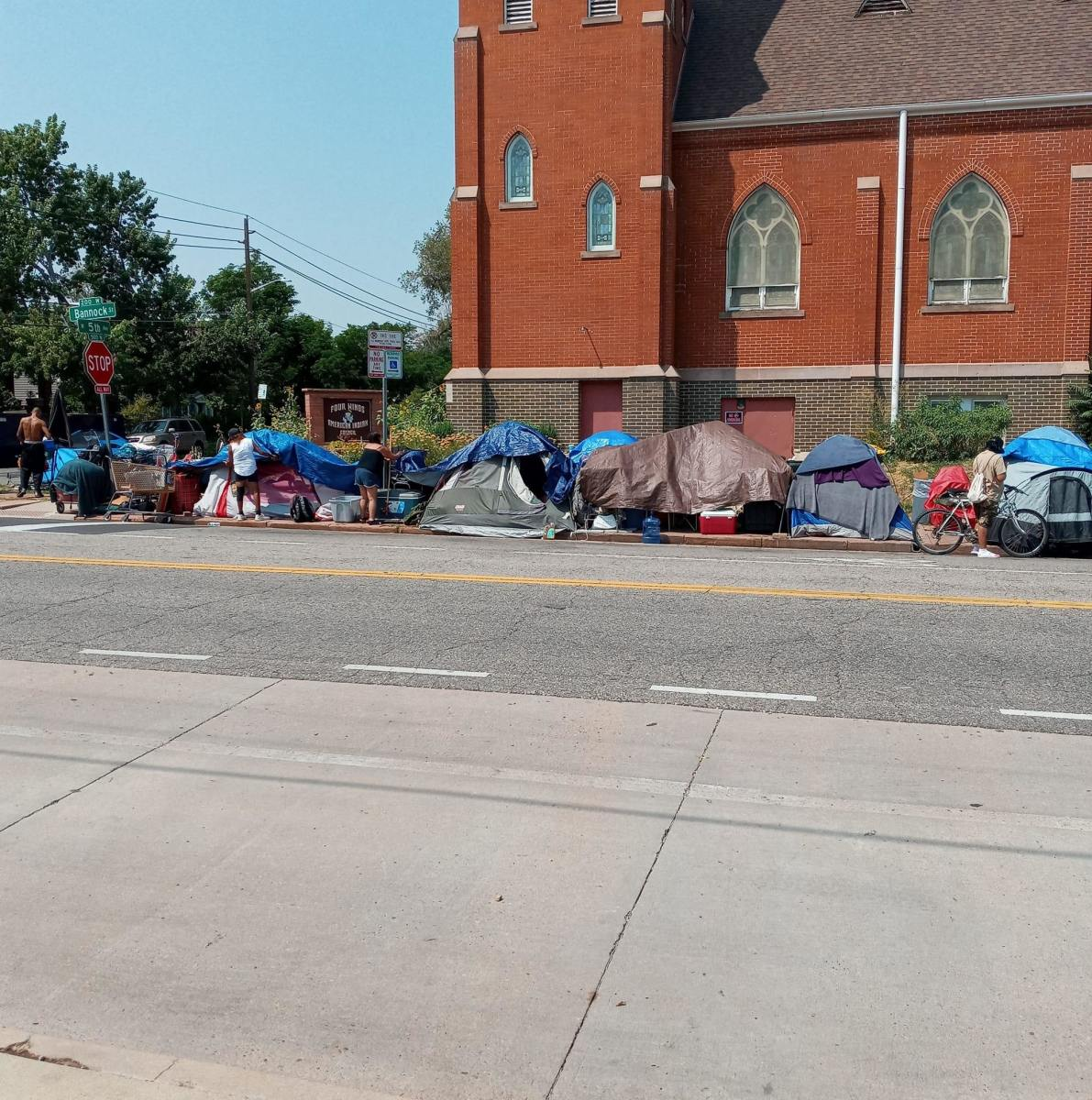 """Pictured: The City of Denver plans to destroy the Denver Indigenous Refugee Camp"""" outside the Four Winds Indian Council building and displace its unhoused Native residents in the early hours of August 31, 2021."""