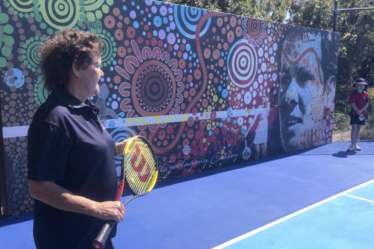 Evonne Goolagong Cawley, left, speaks as she returns to her tennis past in Noosa, Australia, Monday, Aug. 30, 2021, while hoping to inspire Australia's future in the sport. Goolagong Cawley helps unveil a mural, which will double as a hitting wall, as part of Tennis Australia's National Hitting Wall project at the former world No. 1′s local club. (AP Photo/Dennis Passa)