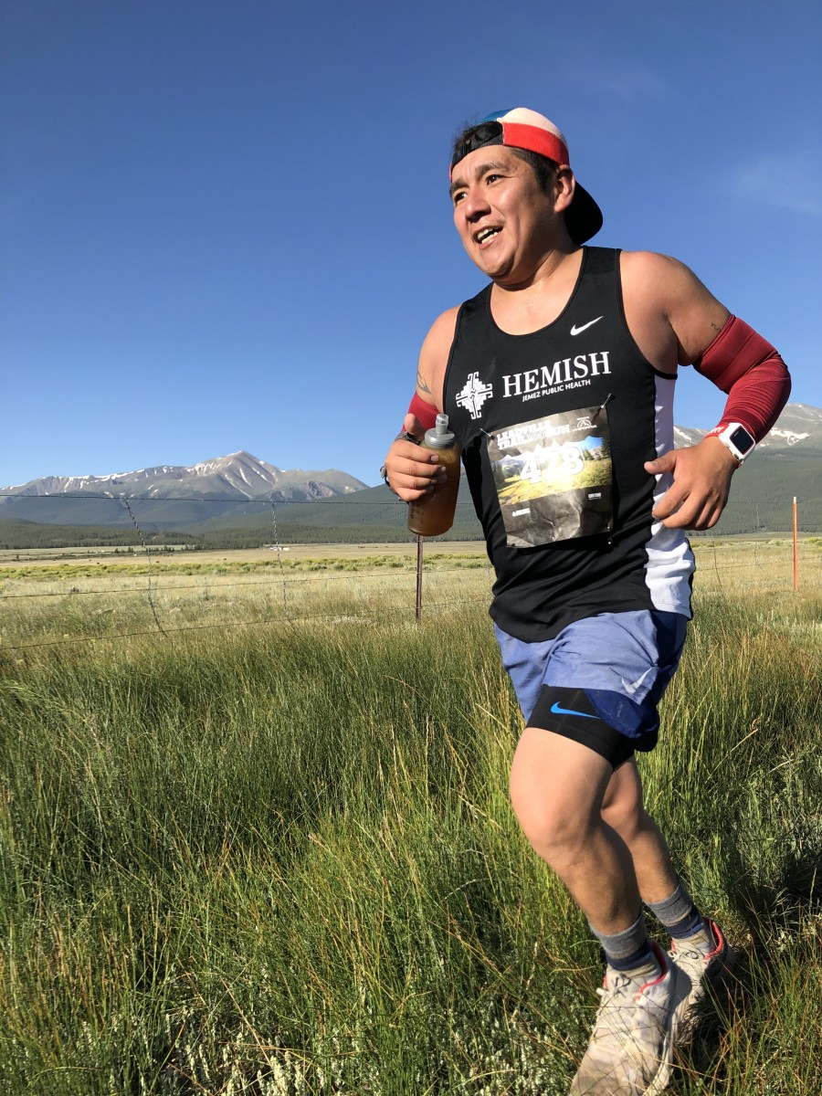 Daniel Madalena, a citizen of the Jemez Pueblo and an ultra-runner in training, sees the impact of climate change as he trains in the Jemez Mountains. Runners see dry lands, wind and smoke from the occasional fire can along the trails. (Photo courtesy of Peter Olson)