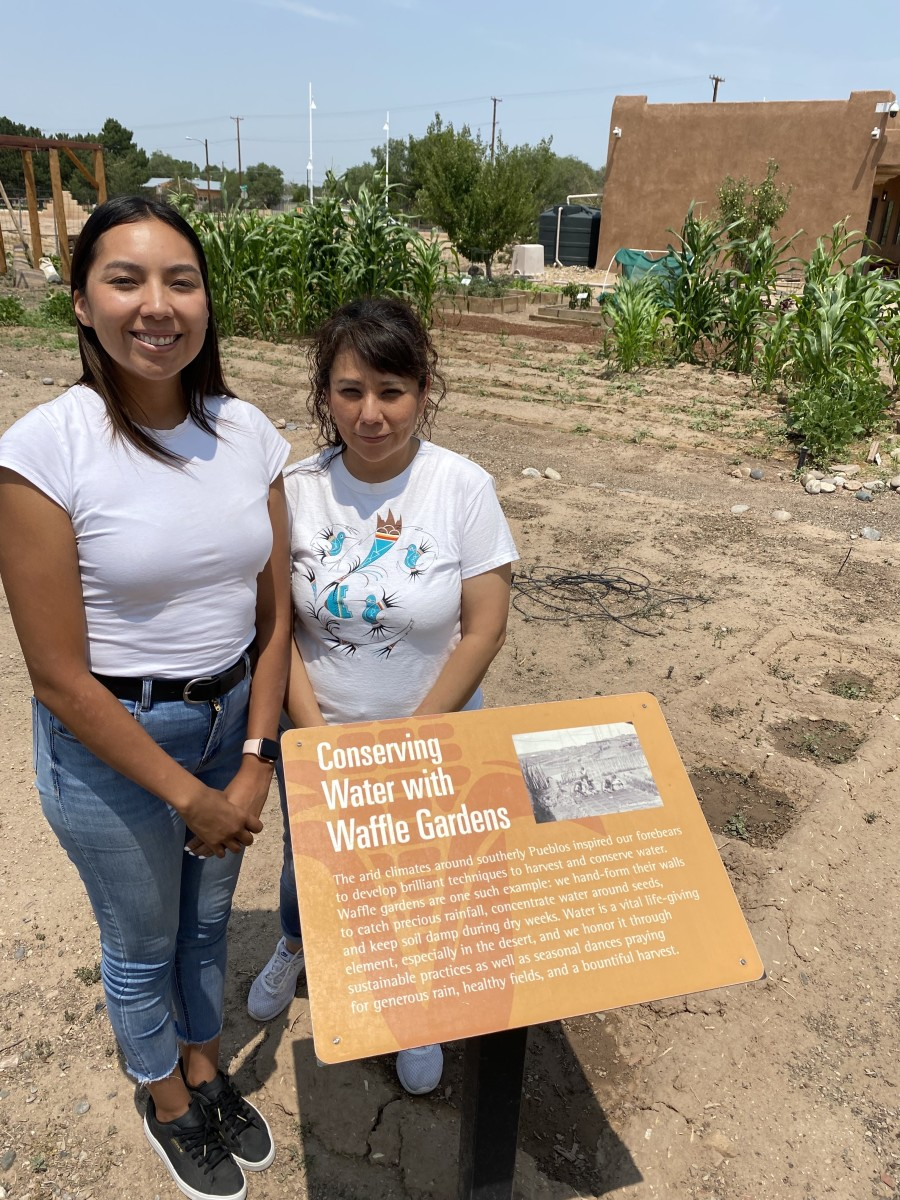 Shannon Romero, Cochiti Pueblo/Santo Domingo Pueblo/Navajo, at right, and her assistant, Rea Thundercloud, took over care and responsibility for the Resilience Garden when the pandemic shut down the Indian Pueblo Cultural Center in Albuquerque, New Mexico.   Romero isthe center's cultural education specialist. They learned about irrigation, planting, crop rotation and adapting to the changing environment. (Photo by Dan Ninham for Indian Country Today)