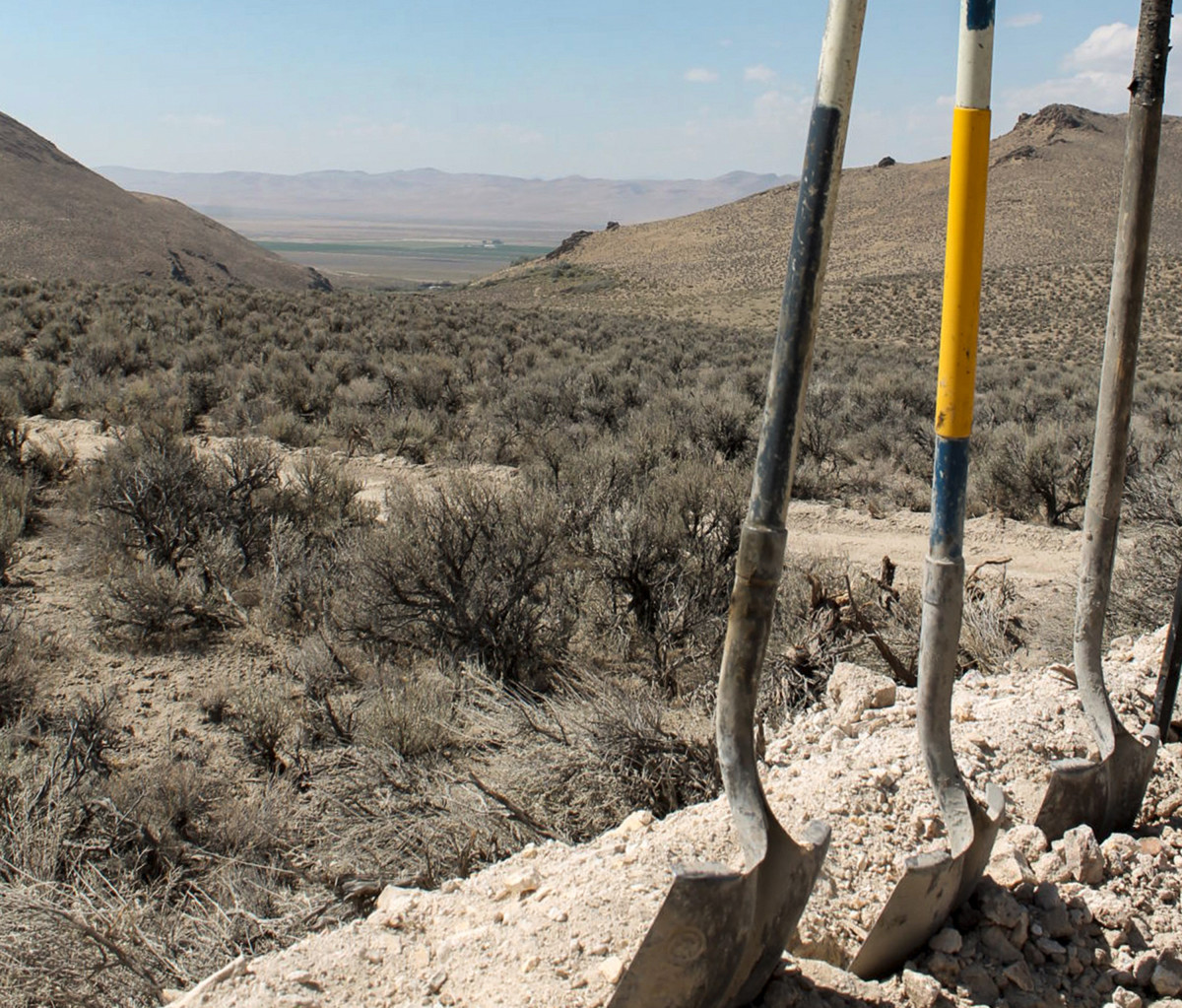 In this Sept. 13, 2018, file photo, exploration drilling continues for Permitting Lithium Nevada Corp.'s Thacker Pass Project on the site between Orovada and Kings Valley, in Humboldt county, Nev., shown beyond a driller's shovels in the distance. A federal judge in Nevada has denied tribal leaders' bid to temporarily block digging for an archaeological study required before construction can begin for a lithium mine. U.S. District Judge Miranda Du refused their request late Friday, Sept. Sept. 3, 2021, for a preliminary injunction blocking the trenching at the site of the largest known lithium deposit in the U.S. (Suzanne Featherston/The Daily Free Press via AP, File)