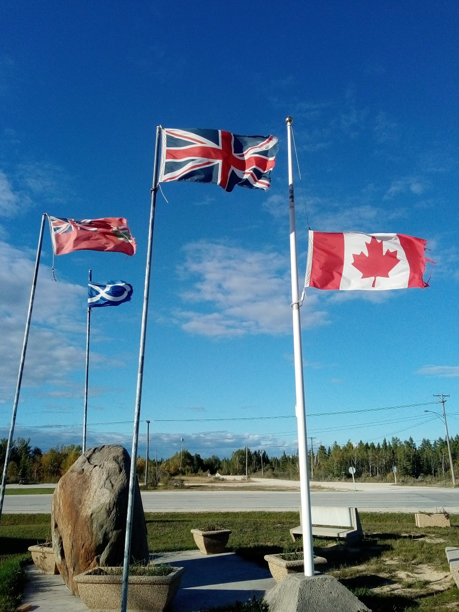 The Canadian flags were lowered following the discovery of unmarked graves next to Indian residential schools in May 2021. Now the issue has entered Canadian politics: Conservative Leader Erin O'Toole saying he would raise the flag if elected prime minister in the Sept. 20, 2021 snap election. (Photo by Miles Morrisseau for Indian Country Today)