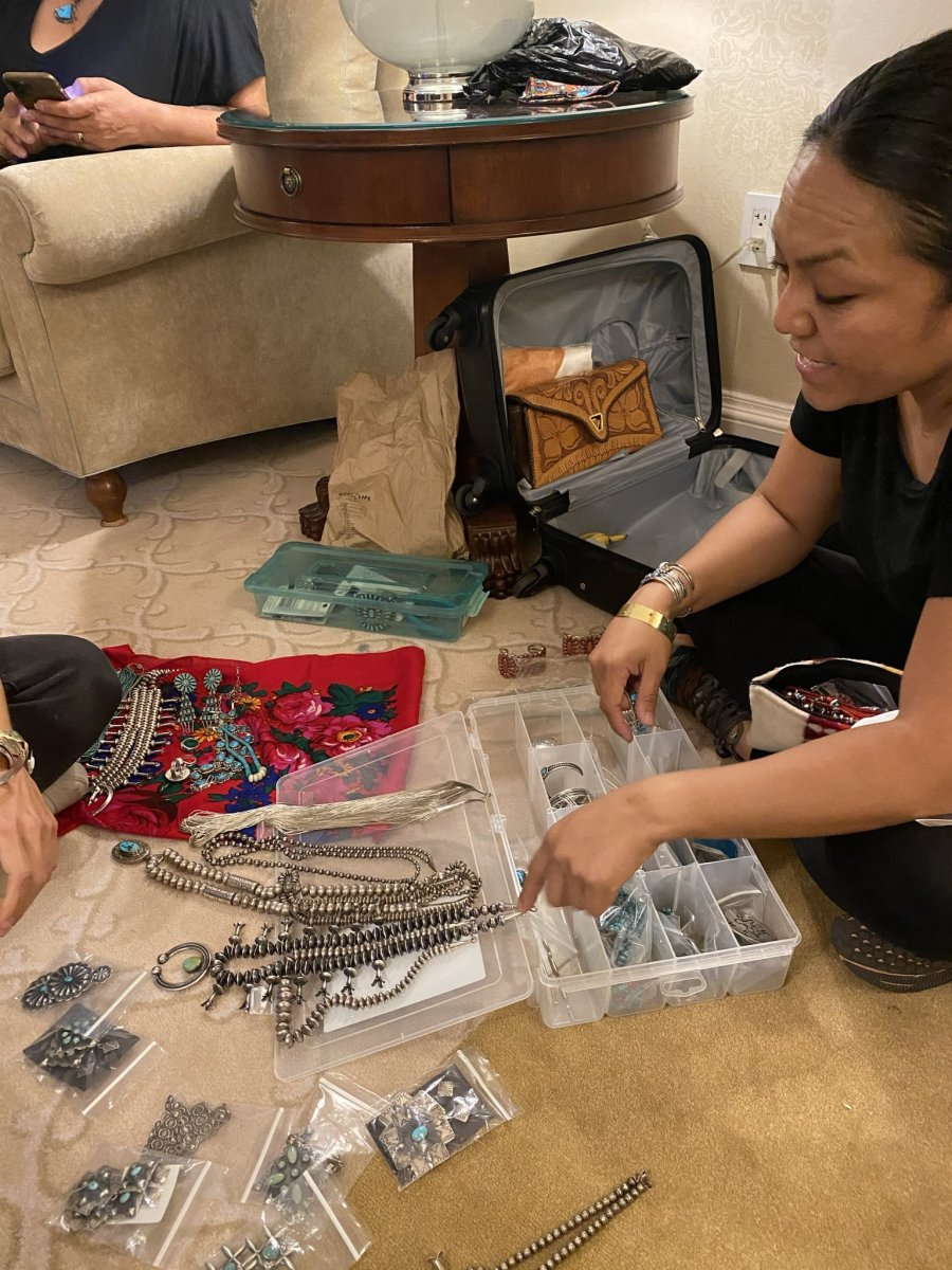 Former Miss Navajo Nation Jocelyn Billy-Upshaw display her collection of Diné turquoise jewelry made by artists in the southwest. (Photo by Emily Sullivan)