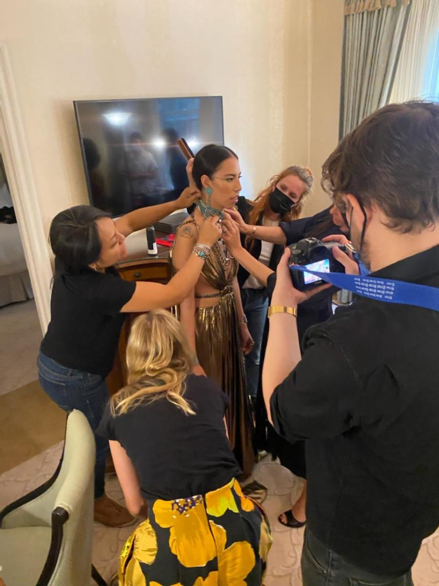 Former Miss Navajo Nation and auntie Jocelyn Billy-Upshaw with stylists and the team completing Quannah Chasinghorse's look for the 2021 Met Gala. (Photo by Jody Potts-Joseph)